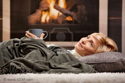6373798-woman-resting-at-home-lying-on-floor-in-front-of-a-fire-place